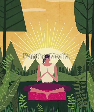 woman meditating in lush woodland at