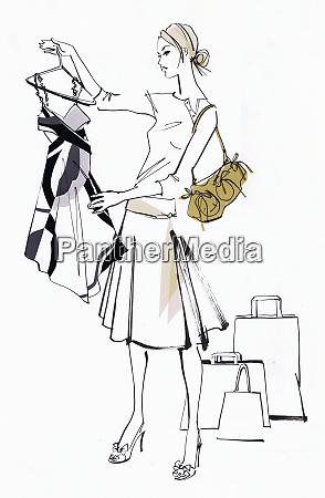 woman shopping looking at dress