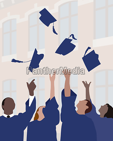 graduates throwing mortar boards in the