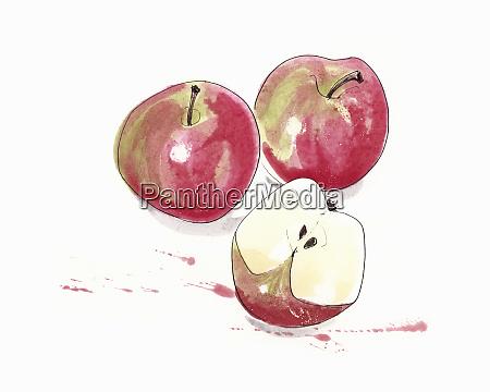 three juicy red apples