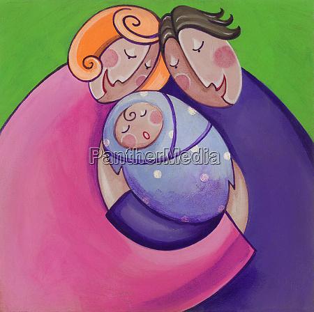 happy parents hugging new baby
