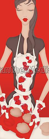 beautiful woman wearing strawberry apron baking