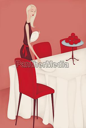 beautiful woman setting dinner table