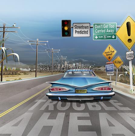 road signs warning car of economic