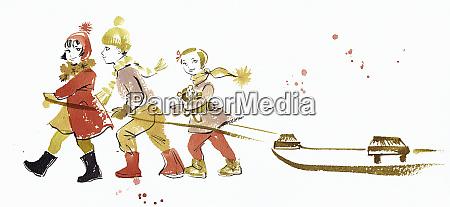 children pulling toboggan in snow in