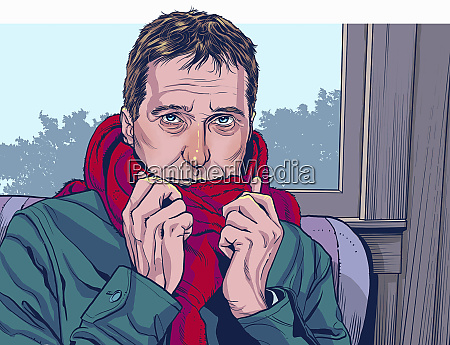 man feeling cold sitting indoors wrapped