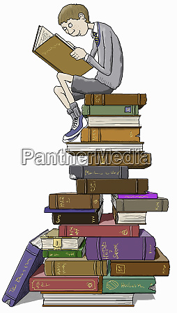 schoolboy reading sitting on top of