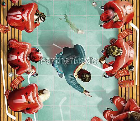 overhead view of ice hockey coach