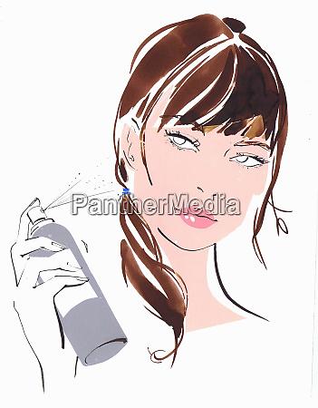 close up of beautiful woman spraying