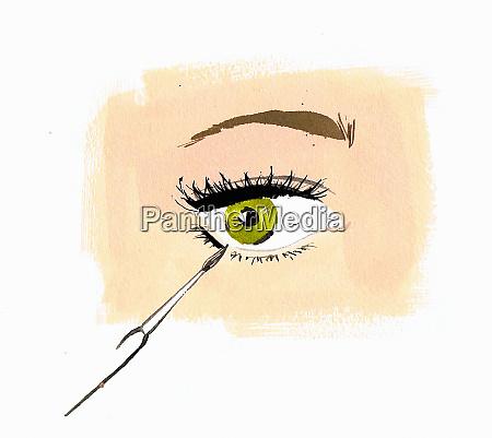 close up woman applying eye liner