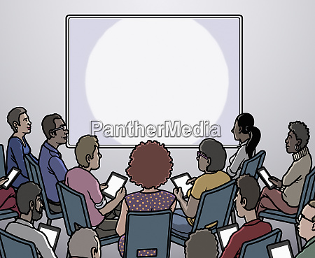 group of people looking at blank