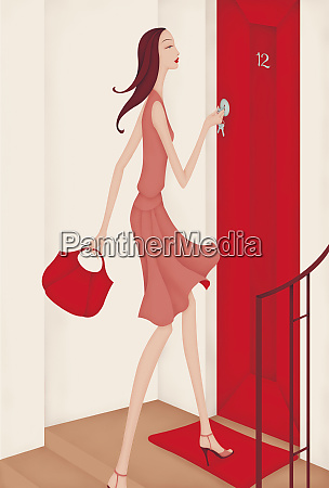 beautiful woman carrying purse arriving home