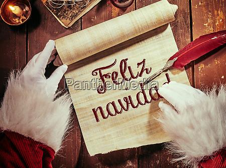 handwritten feliz navidad or merry christmas