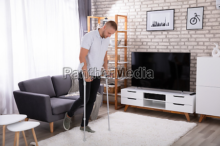 disabled man walking on carpet