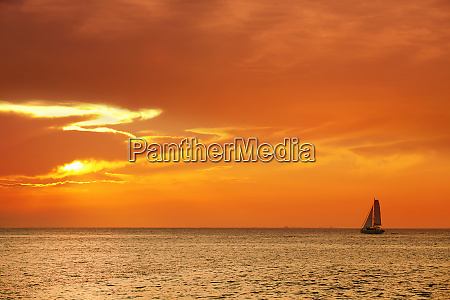 orange color seascape image with shiny