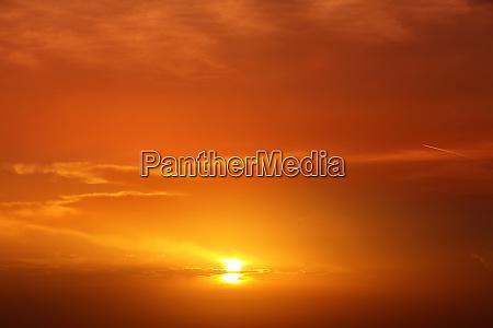 beautiful cloudscape of orange colored sunset