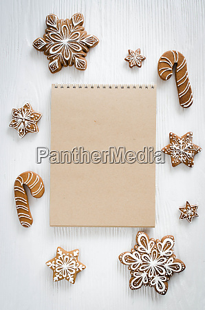 christmas gingerbread and brown notebook on