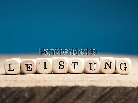 german word effort on wooden dices