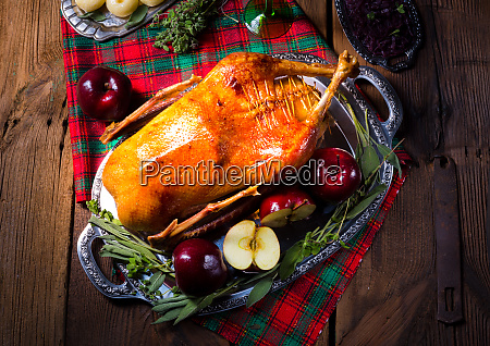 festive stuffed roast goose with red