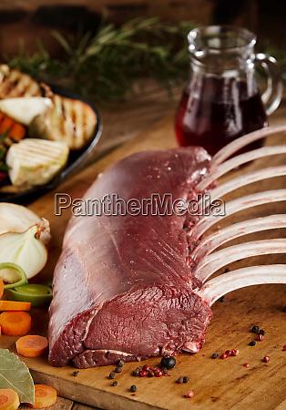 rack of ribs on chopping board