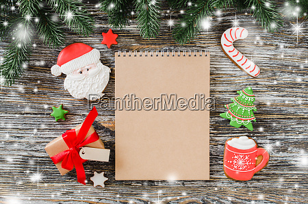 christmas background with brown notebook and