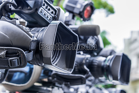 professional tv cameras on tripods recording
