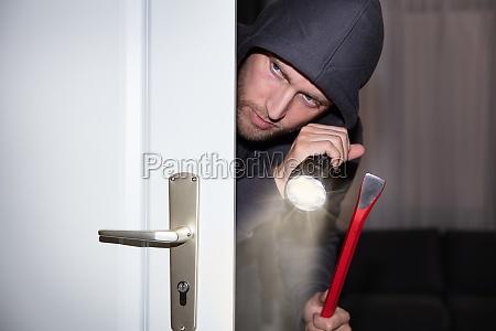 thief peeking from door