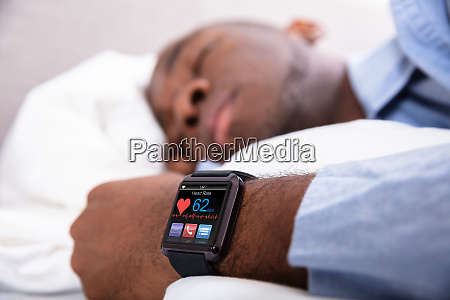 man sleeping with smart watch in
