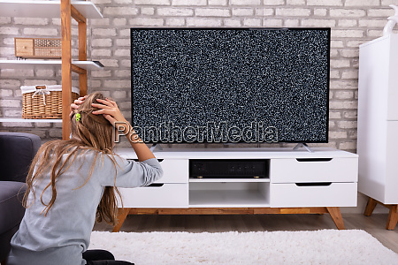 girl sitting near television with no