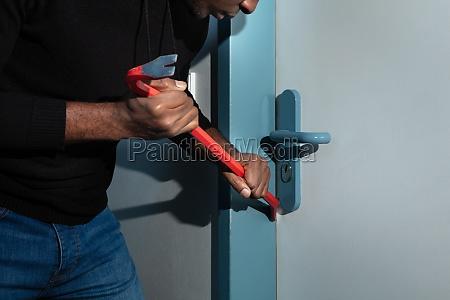 thief trying to break the door
