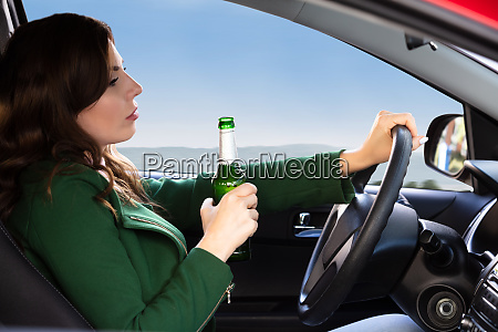 woman, holding, beer, bottle, while, driving - 26052547