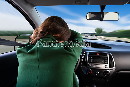 woman, sleeping, while, traveling, by, car - 26052550