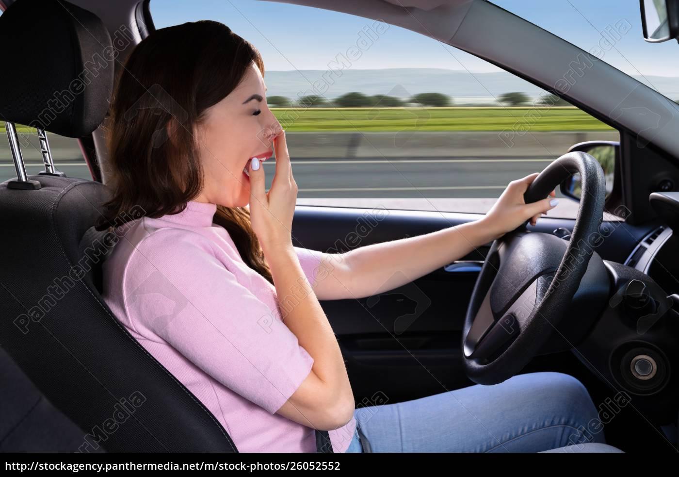 woman, yawning, while, driving, car - 26052552