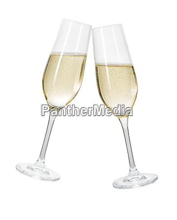 two champagne glasses on a white