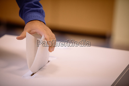 person voting casting a ballot