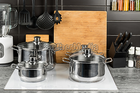 cooking pots in kitchen on white