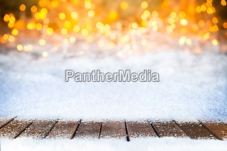 empty snowy wooden planks christmas bokeh