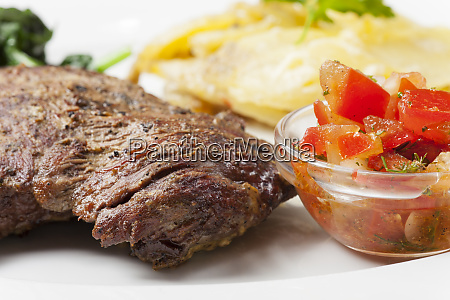 beef steak with a potato gratin