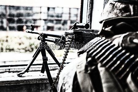 commando machine gunner soldier firing from