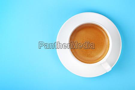 full white cup of espresso coffee