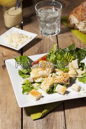caesar salad on rustic wood