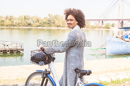 mixed race black woman with bicycle