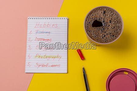 spiral notebook with a hobbies list
