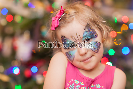 cute girl with butterfly face paint