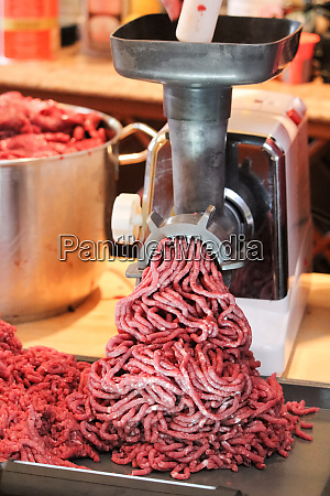 processing and grinding moose meat at
