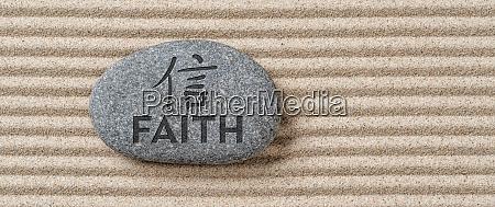stone with the inscription faith