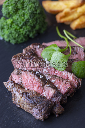 slices of a grilled steak on