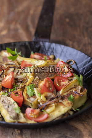 swabian maultasche with onions in an