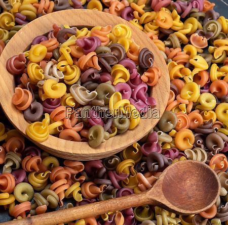 multicolored spiral raw pasta fusilli