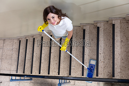 janitor cleaning staircase